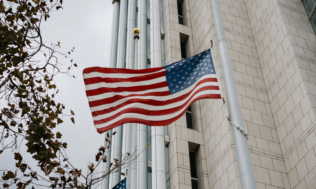 American flag in front of government building